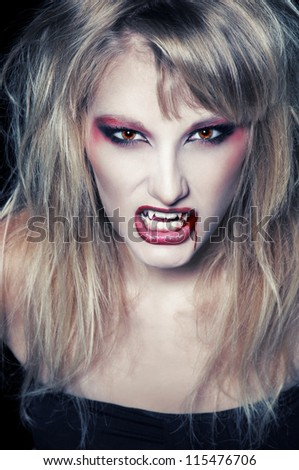 The portrait of a blond girl vampire with bloody streaks