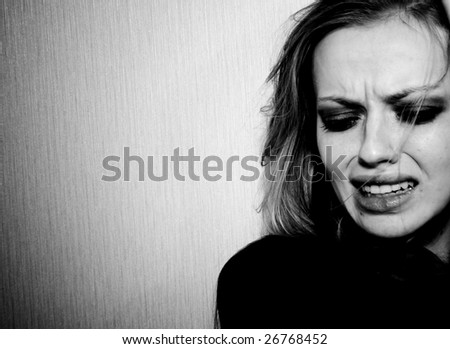 The portrait of crying girl. Great pain.