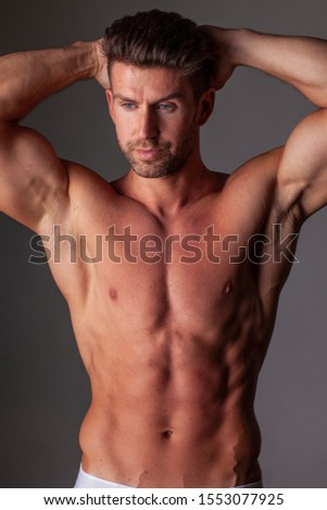 The portrait of muscular handsome model.