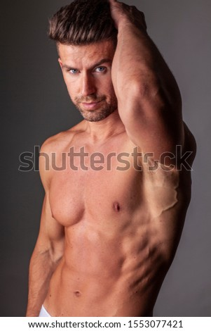 The portrait of muscular handsome model without t-shirt.