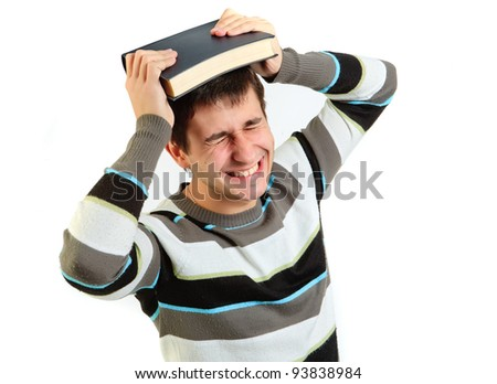 the portrait of student with book on the head against a white background