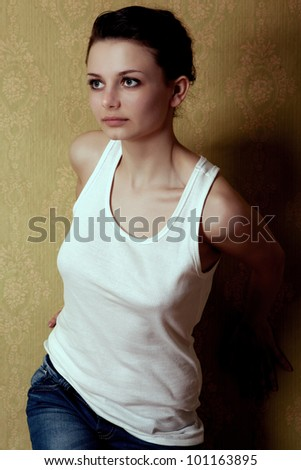 The portrait of the young girl on the vintage background