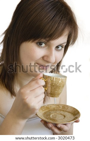 The portrait of young brunette woman with a cup of coffee