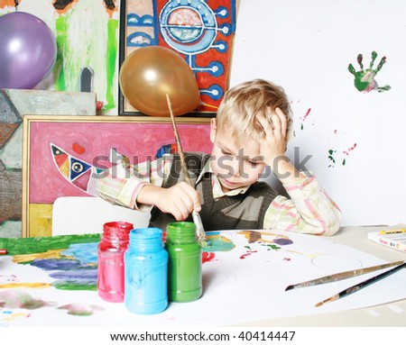The portrait, the boy drawing by paints