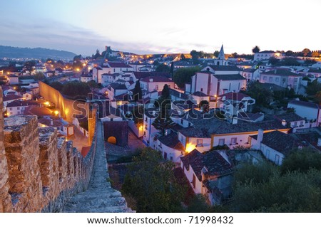 The Portugal town of Obidos is located on a hill and is still encircled by a fortified wall