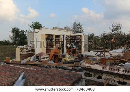 The power of nature's fury, as well as it's perplexity, is displayed in this image of books still on their shelves while the building that housed them succumbed to 200+ mph winds of a EF5 tornado.
