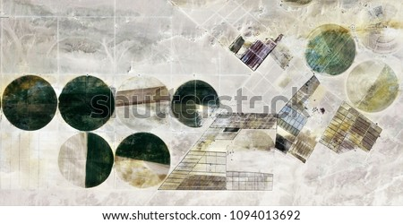 The power of the wind, farms of human crops in the desert, tribute to Pollock, abstract photography of the deserts of Africa from the air, aerial view, abstract expressionism, abstract naturalism,