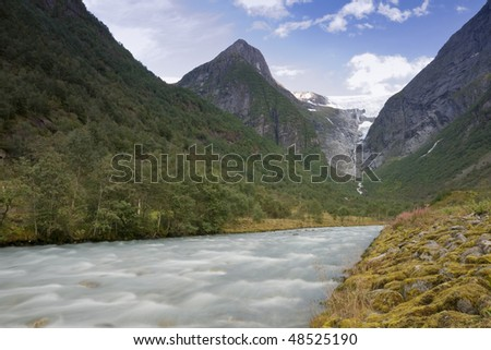 The powerful Briksdal Glacier is a part of the Jostedal Glacier National Park. The wild glacier swoops down from a height of 1200m to the lush, narrow Briksdal Valley.