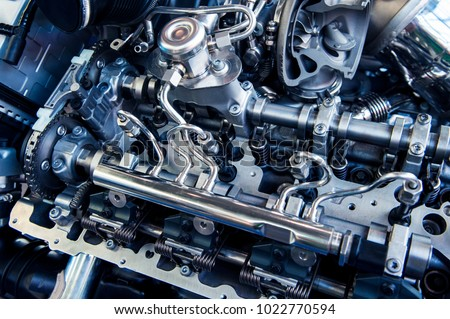 The powerful engine of a car. Internal design of engine. Car engine part. Modern powerful car engine. #1022770594