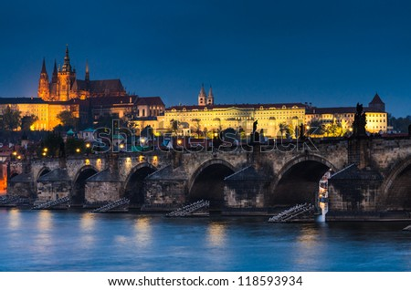 The Prague Castle (built in gothic style) and Charles Bridge are the symbols of Czech capital, built in medieval times. Twilight view of Prague