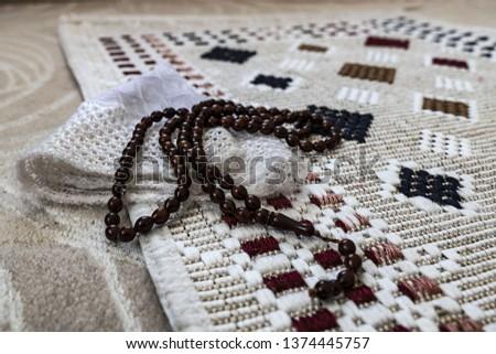 The prayer rug  prayer beads  prayer hat  #1374445757
