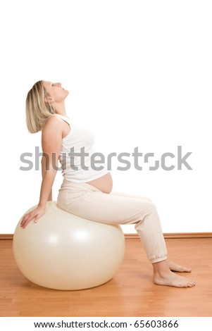 the  pregnant woman practicing physical exercise