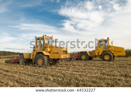 the preparation of land for growing crops with heavy agriculture tractors and Disc harrows
