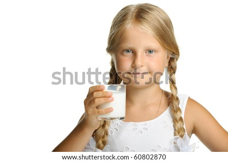 The pretty girl with a glass of milk. It is isolated on a white background