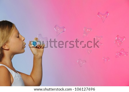The pretty girl with bubbles heart. A  blue background