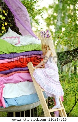"""the princess gets on a bed. the fairy tale """"the princess on a pea"""""""