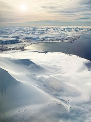 The pristine snow covered mountain tops and arctic ocean of Svalbard, a Norwegian archipelago between mainland Norway and the North Pole. This is an unspoiled and largely untouched arctic wilderness.