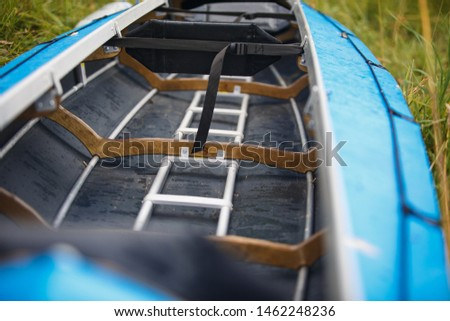 The process of assembling and repairing kayaks: metal skeleton, PVC skin, wooden and aluminum frames. Male hands assemble the canoes and paddle boating.