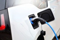 The process of charging an electric vehicle. Electric car socket.