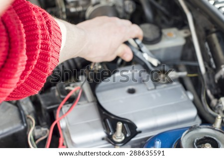 The process of connecting the charger to the the vehicle battery for charging