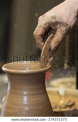 The process of creating pottery by hand
