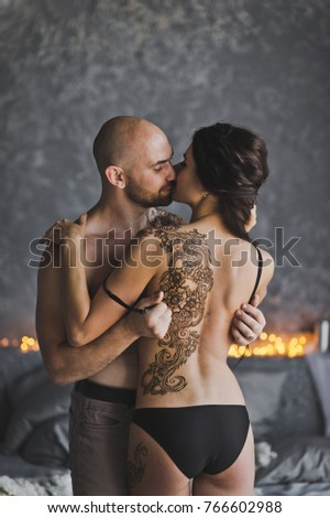 Stock Photo The process of exposure of a female back tattoo.