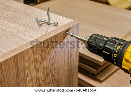 the process of furniture assembly screws closeup #540481654