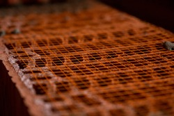 The process of laying out a brick wall. Brickwork close-up. The wall is made of red brick. Close-up of brickwork construction work.