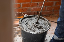 The process of mixing cement mortar before applying to the wall. Work with a construction mixer.
