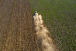 The process of preparing the land for sowing cultivated plants, view from the top of the field cultivation process, Ukrainian fertile lands.2021