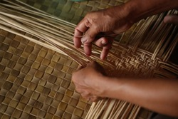 The process of processing raw rattan into woven rattan. Some are made of rattan bags, some are mats. Usually those who work on rattan craft are women. Equipment used is also simple tools.