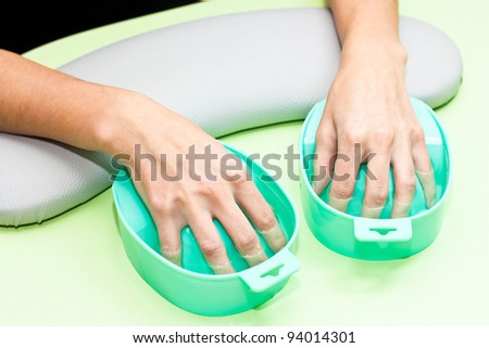 The process of steaming hands before manicure - stock photo