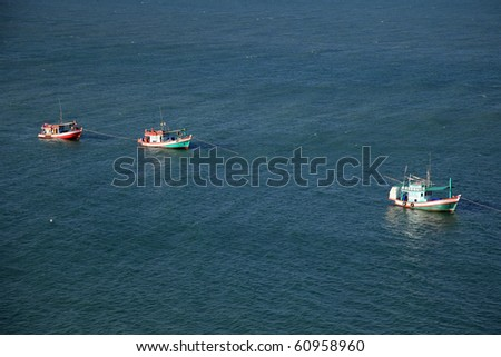 The procession of fishing boats in the Thai gulf.