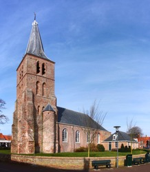 The protestant church in Domburg village with its gothic brick tower in Veere municipality, Zeeland, the Netherlands