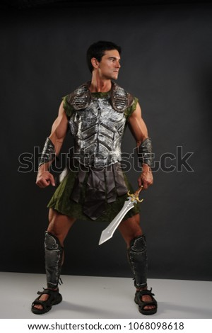 The proud gladiator holds his sword confidently.