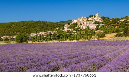 The Provence hilltop perched village of Simiane-la-Rotonde in summer with lavender filed. Alpes-de-Hautes-Provence, France Stock photo ©