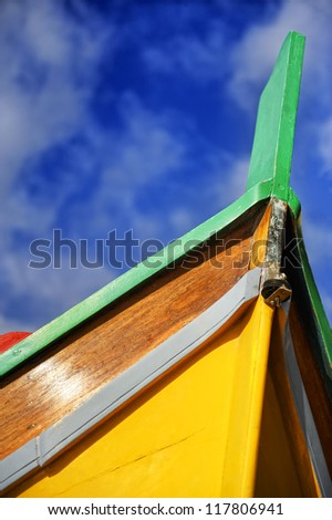 The prow of a traditional Luzzu Maltese fishing boat at St Julians harbour, Valletta, Malta, Europe