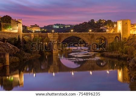 Shutterstock The Puente de San Martin in Toledo, Spain, before sunrise