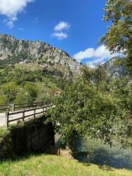 The Puente Mexico Bridge over the Cares river near Mier village in Picos de Europa National Park in Asturias, Spain.