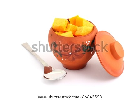 The  pumpkin in the orange pot for cooking - stock photo