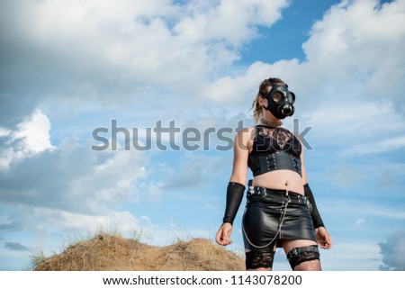Stock Photo The punk rebel from a dystopian future wearing a gas mask