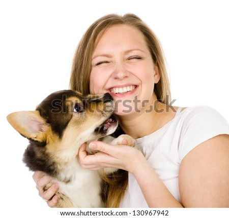 the puppy bites the girl. isolated on white background