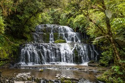 The Purakaunui Falls, a cascading waterfall in the Catlings National Park, Otago on the Southern Island of New Zealand