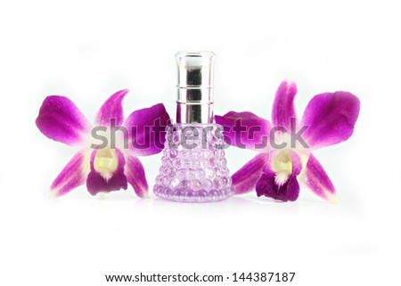 The Purple orchid and  Purple Perfume bottles on the white background.