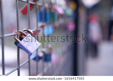 the purple padlock may describe your love to someone who doen't know your love Stockfoto ©