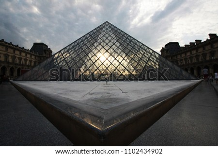 The pyramid glass in the time of sunset - Shutterstock ID 1102434902