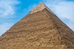 The pyramid of Khafre more precisely Khafra is second largest ancient Egyptian pyramid. Located next to the Great Sphinx, Pyramid Of Khafre In Giza Pyramid Complex, Cairo, Egypt. view from the base