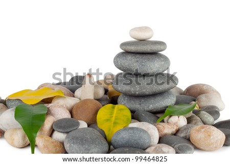 The pyramid of round stones with leaves isolated on white background Foto stock ©