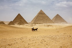 The Pyramids plateau is dominated by the massive pyramids of Khufu (Cheops), Khafre (Chephren), and Menkaure (Mycerinus), all of whom ruled Egypt during the 4th Dynasty.