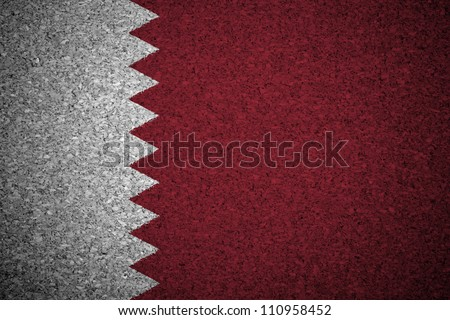 The Qatari flag painted on a cork board.